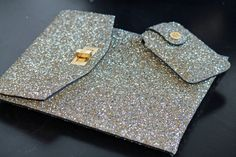 The lovely Victoria of FeatherFrills gives the glitter gadget cases a mention when we met at LFW