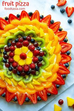 Fruit Pizza - The BEST summer dessert! With a soft sugar cookie crust, dreamy cream cheese frosting, and topped with fresh fruit. Super simple to make and always a hit! Cream Cheese Topping, Cream Cheese Frosting, Best Summer Desserts, Fun Desserts, Fruit Pizza Cookies, Pillsbury Sugar Cookie Dough, Chocolate Raspberry Cheesecake, Cheese Fruit, Soft Sugar Cookies