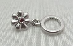 New & Authentic Endless Garnet Flower Dream Dot Drop Sterling Silver Charm  #Endless now available at Keswick Jewelers in Arlington Heights, IL 60005 P: 847.394.9365