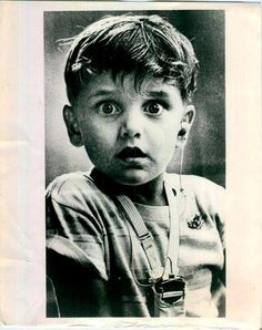This photo taken by photographer Jack Bradley in 1974 depicts the exact moment this little boy, Harold Whittles, hears for the very first time ever after the doctor placed an earpiece in his left ear. Great expression on his face! xx