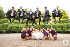 Groomsmen jumping over bridesmaids