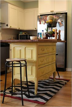 RePurpose: Dresser to an Island. Replace top with granite and add molding to ends and back.