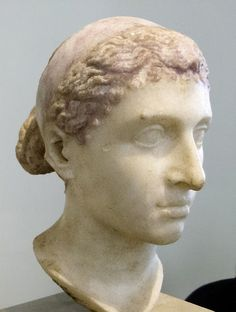 Bust of Cleopatra, 40-30 BCE. In contrast to more modern interpretations of her as a ravishingly beautiful seductress dressed in elaborate clothes and makeup, she is here portrayed rather simply. In fact, many ancient authors described her as...