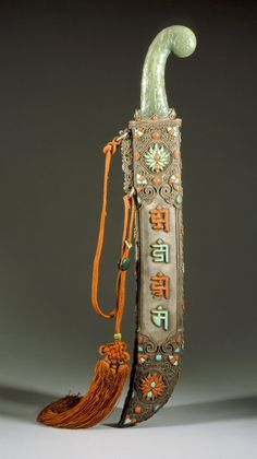 Ceremonial Sword. Eastern Tibet or Mongolia, 18th century.   Steel blade, jade handle; silver sheath inlaid with coral and turquoise; silk tassel