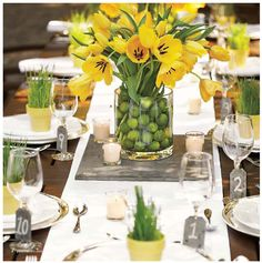 Adding yellow and green makes everyday a summer day! I love mixing flowers and fruit here yellow tulips in a vase of limes!