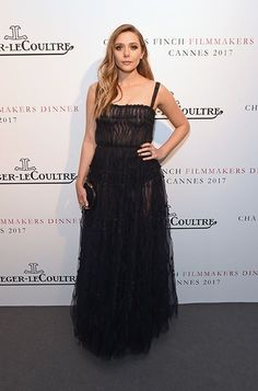 Elizabeth Olsen carrying CLOUD at the 2017 Cannes Film Festival.