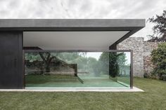 Bergmeisterwolf has completed an extension to a house on the shores of Italy's Lake Garda, featuring glazed walls that disappear into the ground to open the living area up to the garden