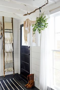 Sticking to a simple black-and-white color scheme gave the space a polished and cohesive look. Painting the walls and ceiling white also takes advantage of the abundance of natural light.