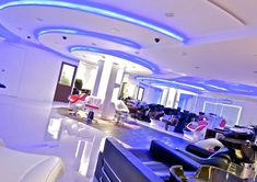 The round ceilings and the play of light gives the store a futuristic feel by A.J Architects. Salon Furniture, Furniture Showroom, Ceilings, Futuristic, Architects, Salons, Play, Contemporary, Interior Design