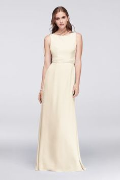Though seemingly simple from the front, this long, flowing gown dips into an eye-catching low back, framed by a soft chiffon cascade. A jeweled detail at the shoulder provides just a touch of refined sparkle.  Wonder by Jenny Packham, a David's Bridal exclusive  Polyester  Back zipper; fully lined  Dry clean  Imported