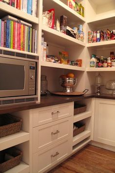 I like this pantry and how the microwave is in there instead of on kitchen counter for those who do not have them built in.  Also good to store cookbooks...keeps them out of kids hands which my kids love to get into mine!!