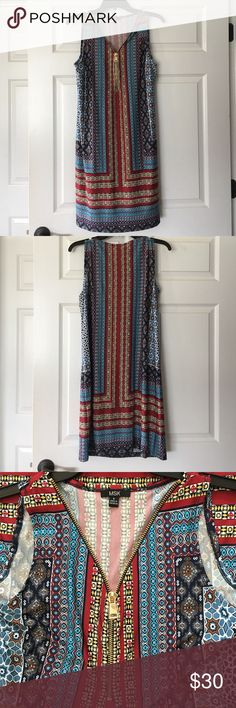 Multicolored dress! Gorgeous slinky material!Soft! Brand New!!!!  Blues, yellow, red, white, rust colored.   Dress it up or dress it down. Looks so good on! Zippered in front past breasts. Size small. True to size. MSK Dresses Midi