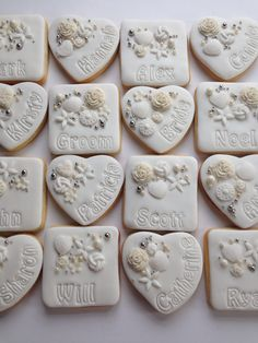 White & ivory personalised wedding cookie favours with guests names. www.cookiedelicious.co.uk