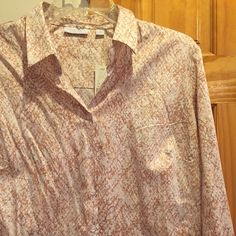 New York & Company Blouse New York & Company Long Sleeve buttoned down blouse color-tones peach, beige and light brown. Size large and 100% brand new with tags. Purchased for $39.99 and it can be yours or give as a gift. New York & Company Tops Blouses