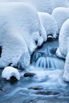 snowy creek - love so much what the cold does to small rivers in winter ...  - better on dark background  -