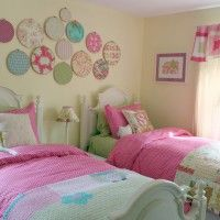 Important Considerations Before Decorating Bedroom for Teens : Modern Twin Girl Bedroom Design Using White Bed Frame Designed With Headboard And Green Fitted Sheet Also Pink White Comforter Also Pillows Combine With Round Fabrics Of Beige Wall Decoration