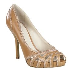 """Peep toe pump with caged detail.  All leather upper with 4 1/2"""" heel and 3/4"""" hidden platform.  This style is available exclusively @ Nine West Stores & ninewest.com."""