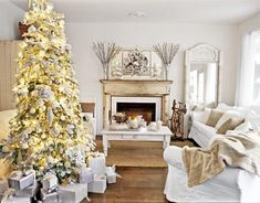 White Christmas Decorations - Bright and White Christmas Home Decor - Country Living by PFR White Xmas, White Christmas Trees, Beautiful Christmas Trees, Christmas Mantels, Noel Christmas, Christmas Tree Decorations, Holiday Tree, White Gold, Winter White