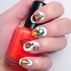 Pin for Later: 102 Halloween Nail Art Ideas That Are Better Than Your Costume Joyful Jack-o'-Lantern Source: Instagram user lisas_nails1