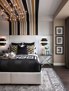 Make a statement in the most intimate space in your home with bold designs and bright hues. The striped wall treatment in the master bedroom of the HGTV Urban Oasis 2013 is inspired by the large white suspension posts of the Bunker Hill Memorial Bridge and draws the eye from the headboard across the ceiling and to the room's opposing wall. Design: Lindsay Pumpa