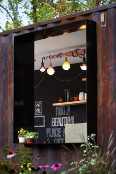 A view into our pop up shipping container cafe the Melbourne International Flower & Garden Show. Designed by Ian Barker Gardens.