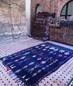Mystical with the deepest shades of blue. A fanstastic vintage pile carpet with a Boucherouite warp. Dusky and sensual with a ground in abrashed blues and a hint of black enlivened with colorful Berber motifs. Measures 268 x 175 cm. Available, for details please contact me per DM.