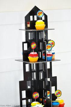Love the city skyscraper cupcake holder! Modern Superhero themed birthday party by Kara Allen | Kara's Party Ideas | KarasPartyIdeas.com-19