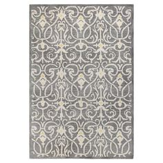 Anchor your dining set or living room seating group with this hand-tufted wool rug, showcasing a damask-inspired motif in grey.   P...