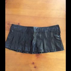 Fetish/rave skirt Super short vinyl skirt from Foreplay. Size is one size but the waist is 33 inches. Foreplay Skirts