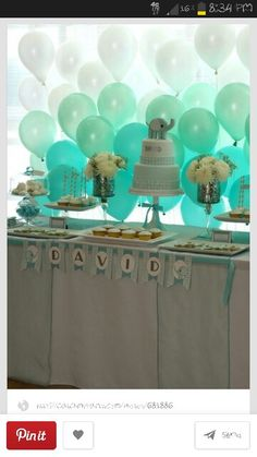 Like the baloons behind the table... could do this with any color scheme.