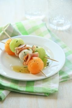 Prosciutto, Melon, and Mozzarella skewers with a tangy basil vinaigrette. Find more mini appetizers at http://weddings.wikia.com/wiki/Mini_Appetizers