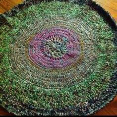 A Crocheted rug. Interesting color combo