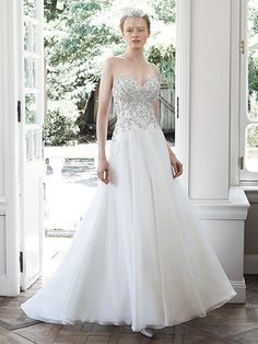 Maggie Sottero - OLYMPIA, With a fully encrusted Swarovski crystal and pearl bodice and flowing skirt This gown has been discontinued by the designer. We have it in the store 60% OFF. Call today before it's gone for good.