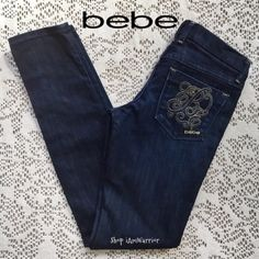 """🆕NWOT rare Bebe monogram B skinny jeans 🎈15% off bundle sale ends Sunday! 🆕NWOT Rare Gorgeous Bebe dark wash skinny premium denim jeans w/ stitch monogram B back pockets. Gold hardware completes this modern jean. Sexy skinny fit and dark wash are very flattering. One of a kind! 32"""" inseam. 👉🏻New items only receive further discounts if bundled. Please read my 'about me' listing for my closet policies before any inquiries/offers. Keep in mind PoshMark takes 20% commission from each buyers…"""