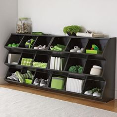 Entryway storage - I think it is strange that all that persons junk matches. Who goes oh gotta buy a green basket ball or else it can't go on the entryway shelf! Shoes too?!