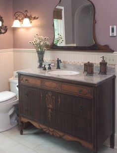 dresser seperated from mirror portion, tile backsplash or wall so mirror is out of splash zone. faucet can be on dresser top or on wall. Sink bowls that sit on top and granite or marble surface protection. Then dresser value is saved.