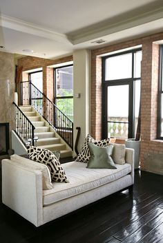 The exposed brick; the floors; the stairs.... yumminess