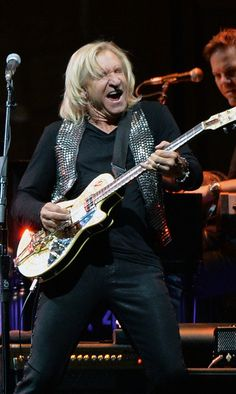 Joe Walsh of the Eagles performs during 'History of the Eagles Live in Concert' at the Bridgestone Arena on October 16, 2013 in Nashville, T...