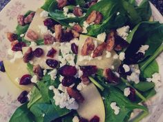 The yummiest salad I have made yet! Pear and Spinach Salad. Toppings are crumbled goat cheese, chopped candied pecans and dried cranberries. Dressing was White Wine and Pear Viniagrette :) SO GOOOOD <3
