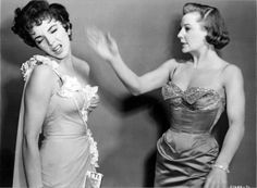Joan Collins is slapped byJune Allyson ina publicity shot for The Opposite Sex (1956)
