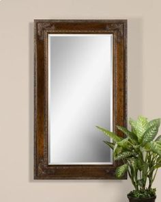 This Stately Mirror Features A Wooden Frame With A Heavily Antiqued Gold Leaf Finish With Black Details And Subtle Green Undertones. Mirror Has A Generous 1 Bevel.Dimensions: x x Black Wall Mirror, Round Wall Mirror, Wall Mounted Mirror, Beveled Mirror, Beveled Glass, Uttermost Mirrors, Mirrors Wayfair, Antique Gold Mirror, Wall Mirror Online