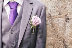 Gray suit, purple tie, lavender flower