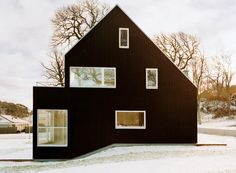 The perfect Scandinavian home. Complete with snow outside and bare trees.