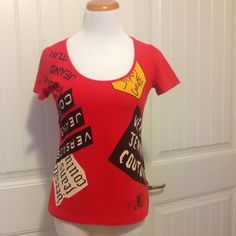 """Versace Jean couture shirt.  So cute Versace Jean couture shirt.  Shirt says L but think it would fit a small or medium better. A stretchy shirt made of cotton & elastane .Measures 17 1/2"""" across from under arm to under arm and 22"""" from shoulder to bottom. Versace Tops"""