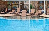 Tanning ledges in the pool allow to keep cool without fully getting wet. Love it!