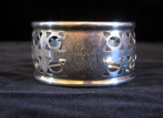 """Vintage Roden Bros. sterling silver monogramed and pierced napkin ring. - $45     This wonderfully crafted napkin ring is in fantastic condition.    Marked on edge """" Sterling, hallmarked with lion passant, R and 925 """".    All Inquiries    or     clientservices@dejavuantiquesandcollectables.com"""