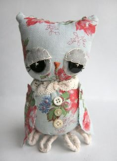 This in Burlap with copper or brass like buttons! AHH! And a orange or pink flower on its head. =]