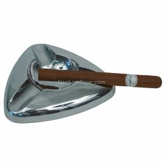 This beautiful metal ashtray that is not only pleasing to the eye but designed especially for cigar smokers. Holds 3 cigars in a compact design perfect for small spaces (3 in. per side)
