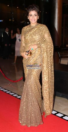 Raveena Tandon at Miss Diva 2013 #saree #indian wedding #fashion #style #bride #bridal party #brides maids #gorgeous #sexy #vibrant #elegant #blouse #choli #jewelry #bangles #lehenga #desi style #shaadi #designer #outfit #inspired #beautiful #must-have's #india #bollywood #south asain