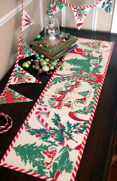 Christmas Craft / Decor Idea: vintage tablecloth turned table runner & bunting <3 | via Into Vintage